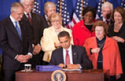Obama signs the Serve America Act, 4/09