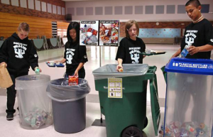Kids sorting trash in the cafeteria.